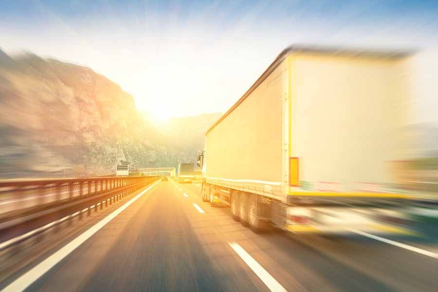 bigstock Generic Semi Trucks Speeding O 95099174 - Avoiding a Truck Wreck on Arkansas Roads and Highways