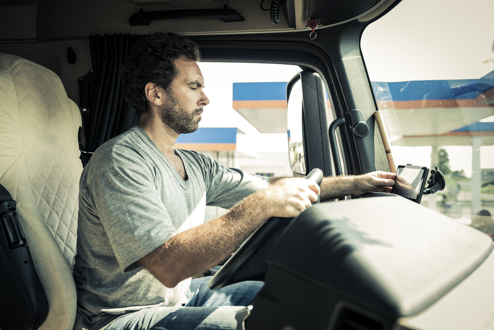 bigstock Portrait of a truck driver 73128457 - When Must Arkansas Truck Drivers Report Workers' Compensation Injuries to Employers?